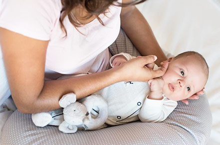 How to Use a Boppy Pillow 9 Best Ways (Breastfeeding, Nursing, Sitting etc.)